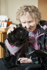 Woman enjoys therapy dog visit