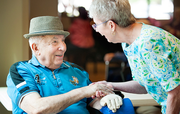 a volunteer greets a resident